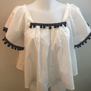 Blue, white shirt with tassels
